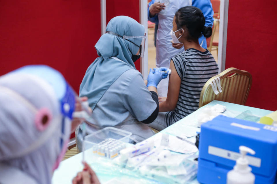 Form 4 and 5 students receive their first dose of the Covid-19 vaccine at MSU University in Shah Alam, September 22, 2021. Health Minister Khairy Jamaluddin said children in Malaysia below the age of 12 might be offered the Covid-19 vaccine in the future. — Picture by Ahmad Zamzahuri