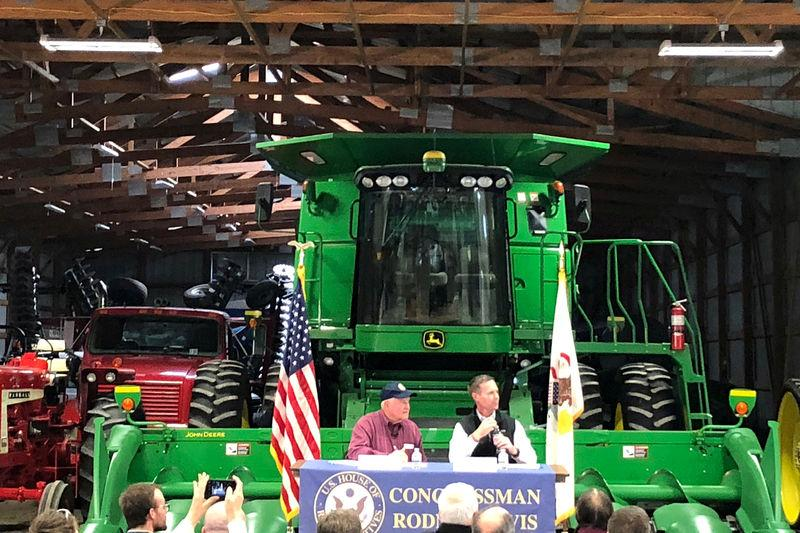 U.S. Agriculture Secretary Perdue and Rep. Davis of Illinois take farmers' questions at a farm in Champaign Illinois