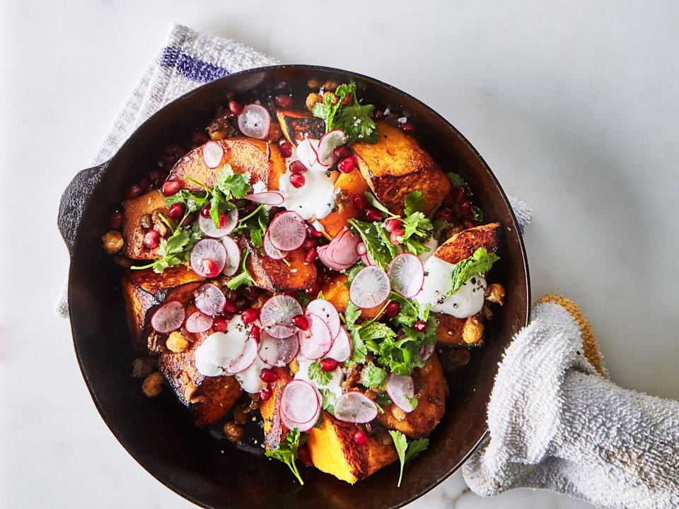 "Stop struggling to peel and slice superfirm squash. Just roast it whole, tear up the flesh, then sear it off in a skillet. <a href=""https://www.bonappetit.com/recipe/one-skillet-roasted-butternut-squash-with-spiced-chickpeas?mbid=synd_yahoo_rss"" rel=""nofollow noopener"" target=""_blank"" data-ylk=""slk:See recipe."" class=""link rapid-noclick-resp"">See recipe.</a>"