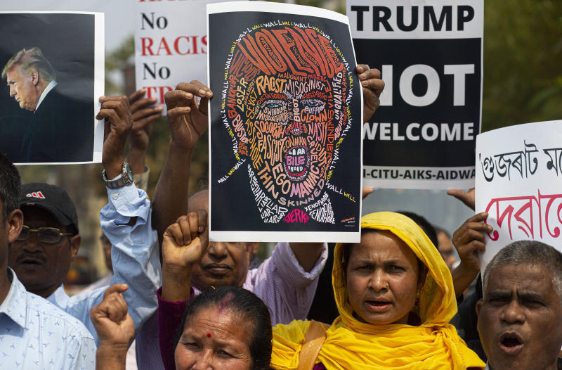 Indian activists shout slogans against the visit of U.S. President Donald Trump, in Gauhati, India, Monday, Feb. 24, 2020. Indian Prime Minister Narendra Modi's Hindu nationalist government is pulling out all the stops, at an expense of more than $14 million, to woo the president and first lady Melania Trump. But experts have said that very little of substance will be achieved for either side beyond the pageantry and symbolism. (AP Photo/Anupam Nath)