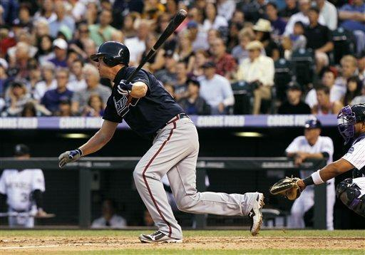 Atlanta Braves' Chipper Jones follows the flight of his RBI-double against the Colorado Rockies in the fifth inning of a baseball game in Denver, Saturday, May 5, 2012. (AP Photo/David Zalubowski)