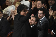 """Bong Joon-ho was seen in the audience before accepting the award for best original screenplay for """"Parasite"""" at the Oscars on Sunday, Feb. 9, 2020, at the Dolby Theatre in Los Angeles. (AP Photo/Chris Pizzello)"""