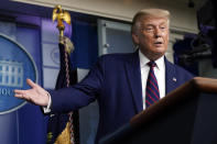 President Donald Trump gestures for Larry Kudlow, White House chief economic adviser, to speak during a news conference in the James Brady Press Briefing Room at the White House, Friday, Sept. 4, 2020, in Washington. (AP Photo/Evan Vucci)