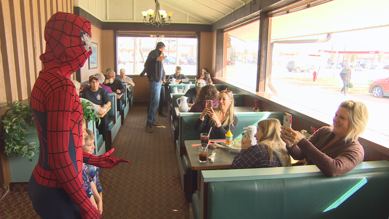 Superhero breakfast raises funds to get service dog for 11-year-old