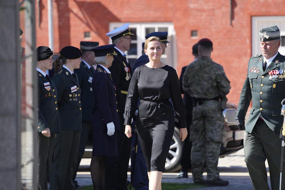 Denmark's Prime Minister Mette Frederiksen (C) arrives at the Military Headquarters Kastellet in Copenhagen, Denmark, during a ceremony marking the Flag Day for Denmark's emissaries on September 5, 2021. - The Flag Day honours people who are or have been sent on a mission by Denmark. - Denmark OUT (Photo by Keld Navntoft / Ritzau Scanpix / AFP) / Denmark OUT (Photo by KELD NAVNTOFT/Ritzau Scanpix/AFP via Getty Images)