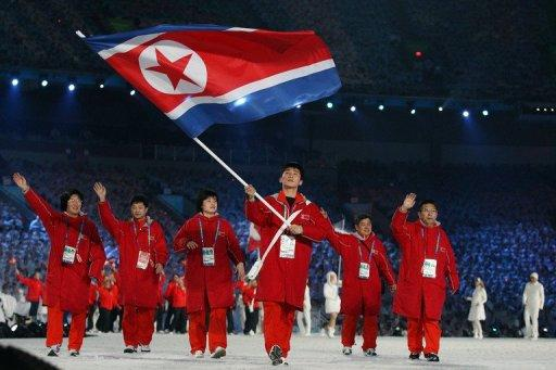 Song Chol Ri of North Korea carries the national flag during the Opening Ceremony of the 2010 Vancouver Winter Olympics