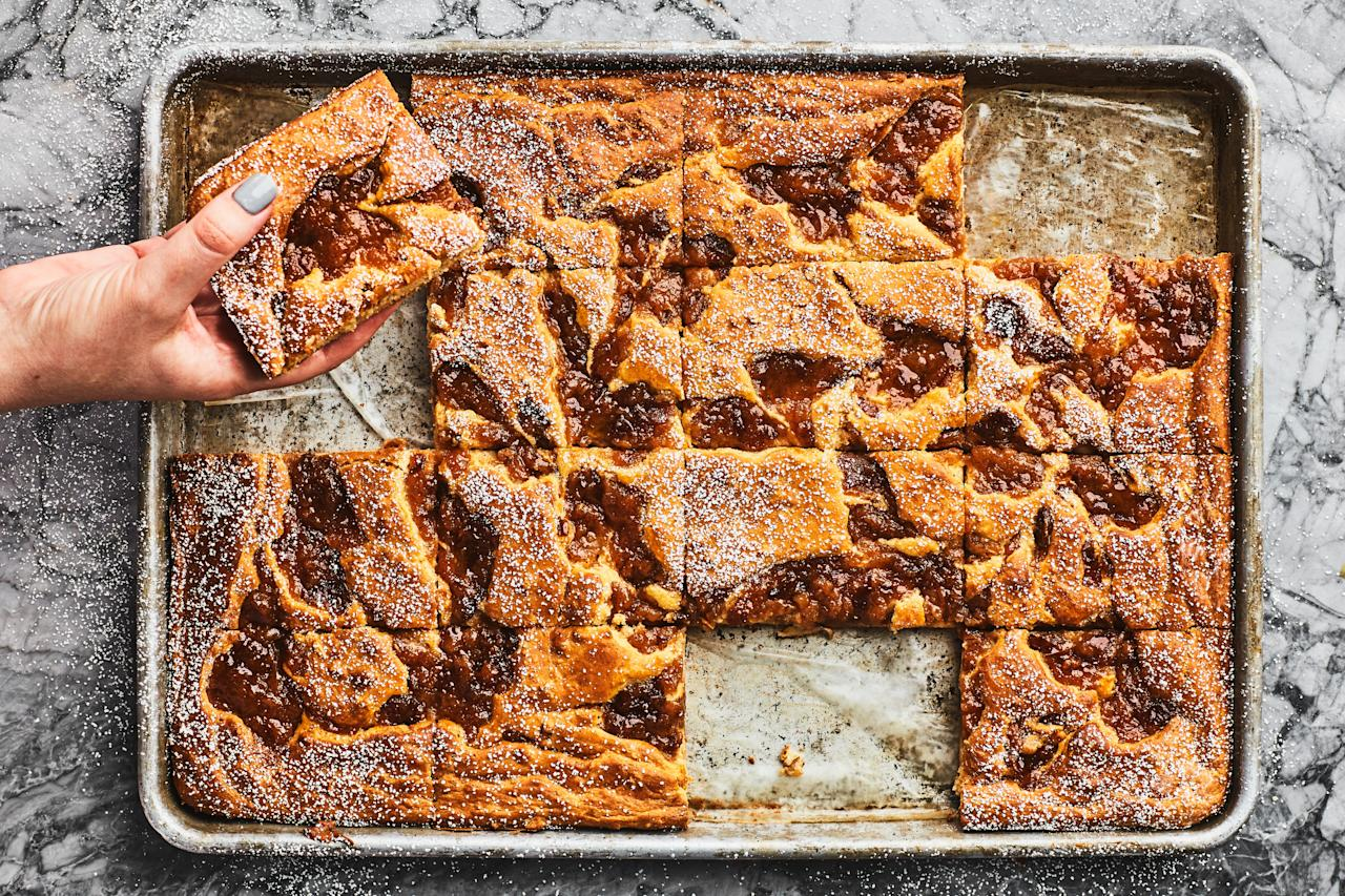 """A swirl of cinnamon-spiced pear compote runs through these protein-rich """"pancakes,"""" which are great for a crowd or as a make-ahead breakfast. <a href=""""https://www.epicurious.com/recipes/food/views/sheet-pan-cider-ricotta-pancakes-with-pear-compote?mbid=synd_yahoo_rss"""">See recipe.</a>"""