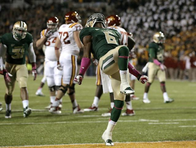 In this Oct. 19, 2013, photo, Baylor safety Ahmad Dixon (6) celebrates a defensive stop against Iowa State deep in Iowa State territory in the second half of an NCAA college football game in Waco, Texas. Dixon takes a deep breath and has the same thought each time he gets to the sideline after a defensive stop. ''I'm just like, Wow, this is really us, this is who we are,'' Dixon said. Baylor won the game 71-7. (AP Photo/Tony Gutierrez, file)