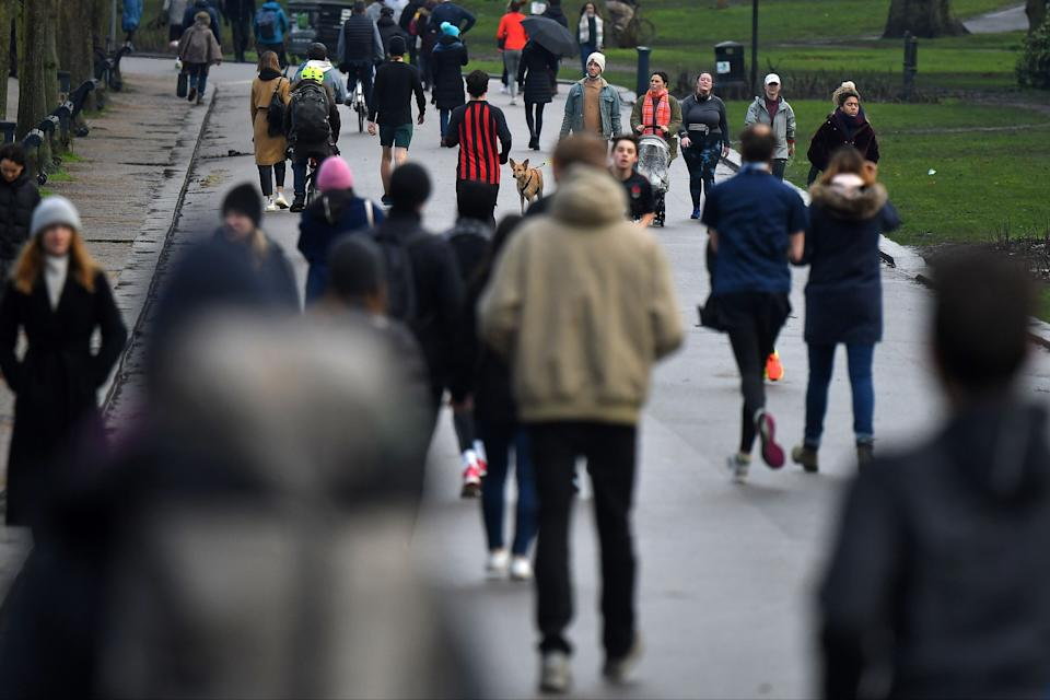 <p>People walk in Victoria Park in east London on Saturday, as life in England continues under lockdown</p> (AFP via Getty Images)