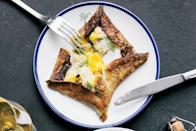 """This all-in-one brunch dish is both luxurious to eat and easy to make. <a href=""""https://www.epicurious.com/recipes/food/views/buckwheat-crepes-with-creamy-leeks-and-baked-eggs?mbid=synd_yahoo_rss"""" rel=""""nofollow noopener"""" target=""""_blank"""" data-ylk=""""slk:See recipe."""" class=""""link rapid-noclick-resp"""">See recipe.</a>"""