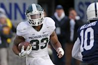 Michigan State running back Jeremy Langford (33) carries the ball for a first down during the first half of an NCAA college football game against Penn State in State College, Pa., Saturday, Nov. 29, 2014. (AP Photo/Gene J. Puskar)
