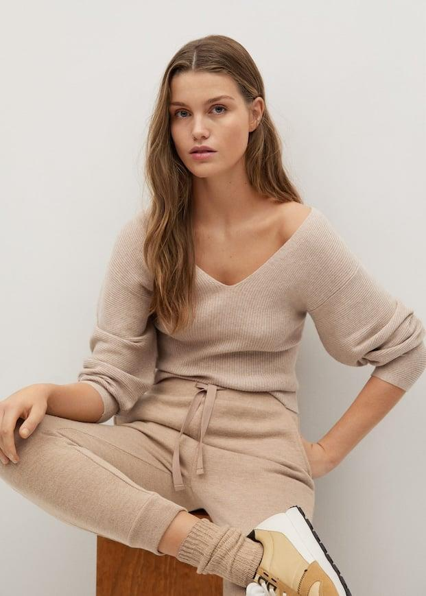 <p>The silhouette of this <span>Mango V-neck Ribbed Knit Sweater</span> ($40) is so elegant.</p>