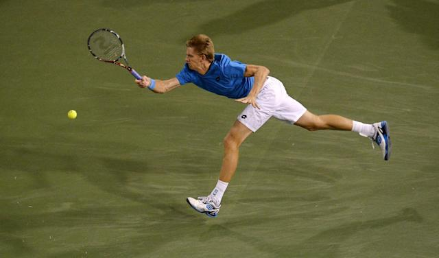 Kevin Anderson, of South Africa, returns a shot to Roger Federer, of Switzerland, during the quarterfinals of the BNP Paribas Open tennis tournament, Thursday, March 13, 2014, in Indian Wells, Calif. (AP Photo/Mark J. Terrill)