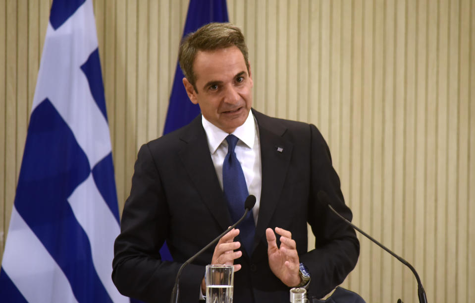Greece's Prime minister Kyriakos Mitsotakis talks during a press conference with Cyprus President Nicos Anastasiades and Egypt's President Abdel-Fattah el-Sissi after their meeting at the presidential palace in capital Nicosia, Cyprus, on Wednesday, Oct. 21, 2020. The leaders of Cyprus, Egypt and Greece meet in the Cypriot capital for talks on forging closer ties and boosting cooperation on issues including energy following the discovery of gas deposits in the east Mediterranean. (Iakovos Hatzistavrou Pool via AP)