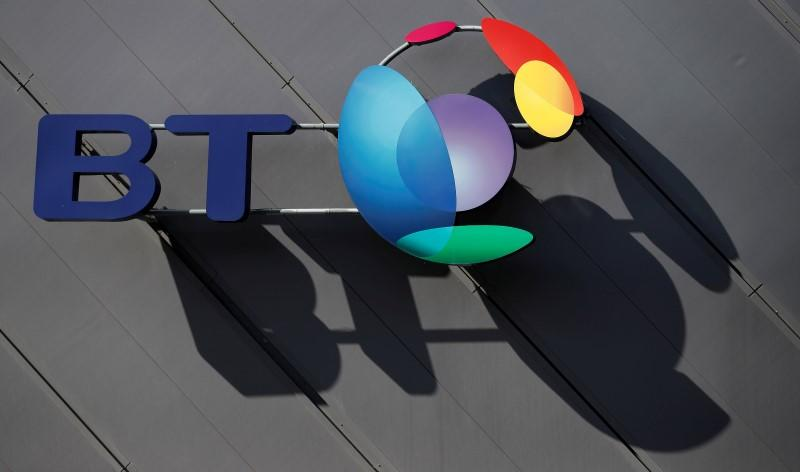 FILE PHOTO: A BT (British Telecom) company logo is pictured on the side of a convention centre in Liverpool, northern England.
