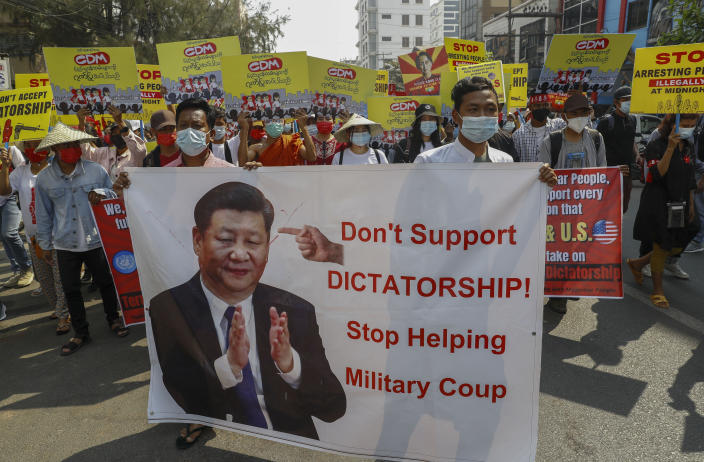 Demonstrators display a picture of Chinese president Xi Jinping, with a message requesting not to support military coup during a protest against the military coup in Mandalay, Myanmar on Wednesday, Feb. 17, 2021. Some protesters have accused Beijing — which has long been Myanmar's main arms supplier and has major investments in the country — of propping up the junta.(AP Photo)