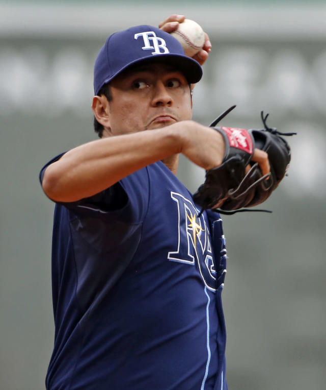 Tampa Bay Rays starting pitcher Cesar Ramos delivers to the Boston Red Sox during the first inning in the first baseball game of a doubleheader at Fenway Park in Boston, Thursday, May 1, 2014. (AP Photo/Elise Amendola)