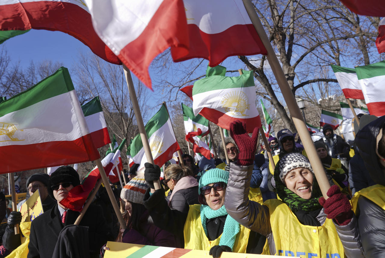 <p>Demonstrators hold Iranian flags during a rally in Lafayette Park across from the White House in Washington, on Saturday, Jan. 6, 2018, in solidarity with anti-government demonstrators in Iran. Iran has seen its largest anti-government protests since the disputed presidential election in 2009. (Photo: Pablo Martinez Monsivais/AP) </p>