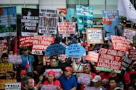 Protestors brandished signs saying 'China out of Philippine waters' in reference to a long-running dispute over the South China Sea