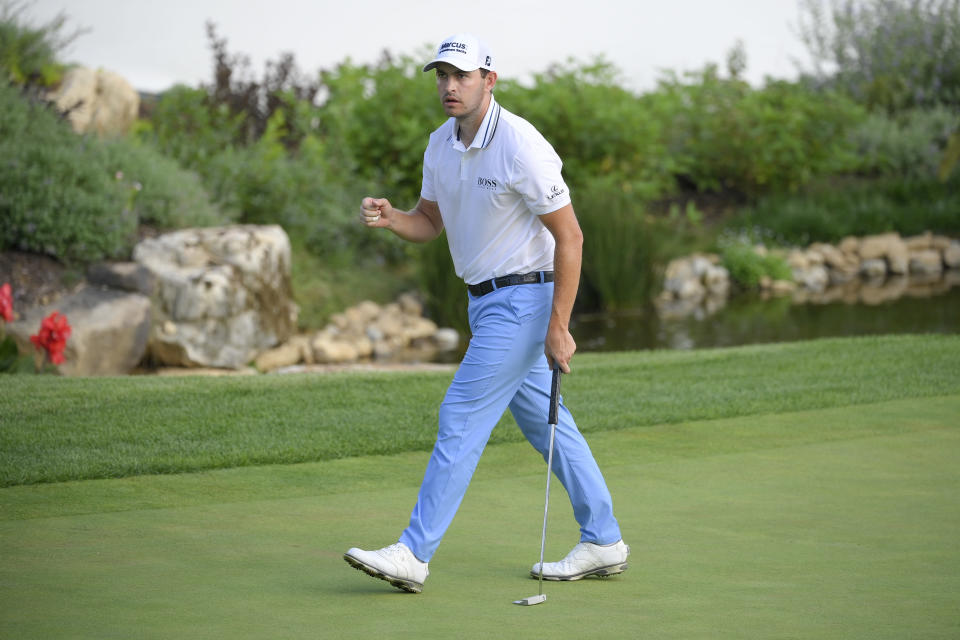 Patrick Cantlay reacts after sinking his putt on the 128th green during the final round of the BMW Championship golf tournament, Sunday, Aug. 29, 2021, at Caves Valley Golf Club in Owings Mills, Md. (AP Photo/Nick Wass)