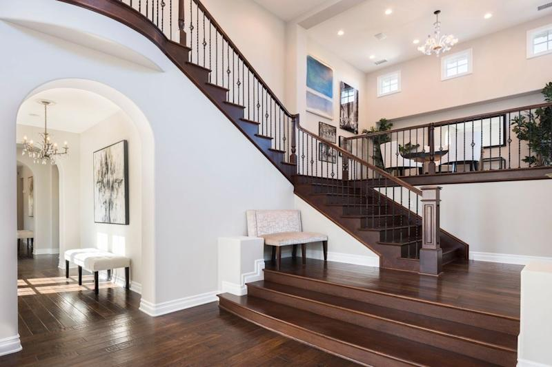 The stairs are a focal point of the main living area.