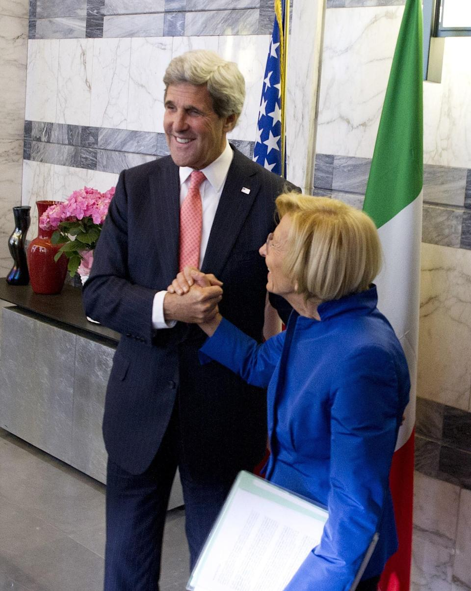 Italian Foreign Minister Emma Bonino, right, and US Secretary of State John Kerry shake hands prior to an official meeting in the Foreign Ministry building in Rome on Thursday May 9, 2013. (AP Photo/Mladen Antonov, Pool)