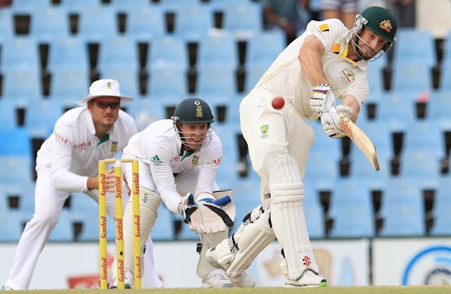 Australia's batsman Alex Doolan, right, plays a stroke shot as South Africa's wicketkeeper AB de Villiers, center, and captain Graeme Smith, left, watch on the third day of their their cricket test match at Centurion Park in Pretoria, South Africa, Friday, Feb. 14, 2014. (AP Photo/ Themba Hadebe)