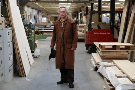 Factory landlord Lawrence Taylor poses in the factory he rents to Enfield Speciality Doors in Enfield, north London, August 12, 2014. REUTERS/Luke MacGregor