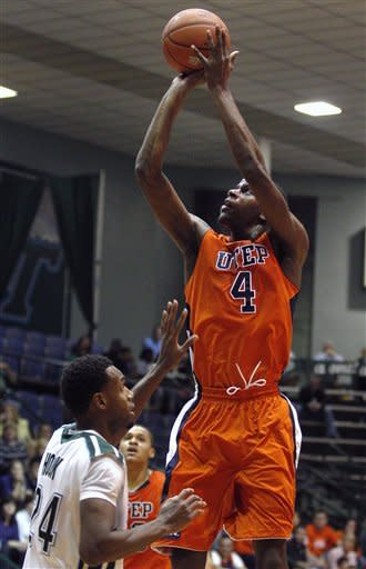 UTEP guard Julian Washburn (4) scores over Tulane guard Jay Hook (24) during the first half of an NCAA college basketball game in New Orleans, Saturday, Jan. 21, 2012. (AP Photo/Jonathan Bachman)