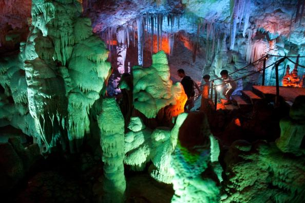 Visitors at the Sorek stalactites cave as it is illuminated with a new lighting system on August 9, 2012 near Beit Shemesh, Israel. The cave, 82 meters long and 60 meters wide, was discovered accidentally by wo