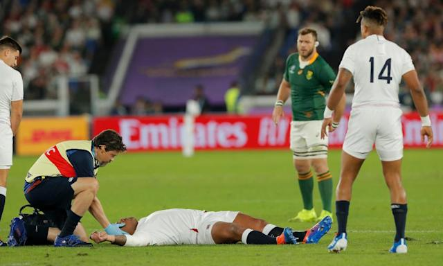 """<span class=""""element-image__caption"""">England's Kyle Sinckler is treated on the pitch before having to go off following a third-minute collision.</span> <span class=""""element-image__credit"""">Photograph: Tom Jenkins/The Observer</span>"""