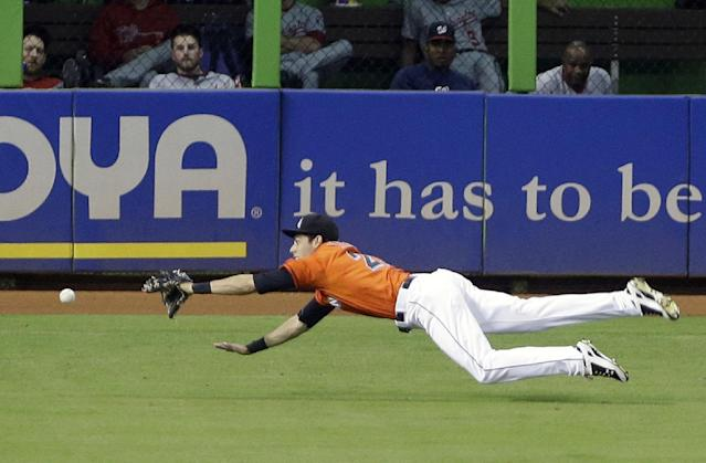 Miami Marlins left fielder Christian Yelich is unable to catch a ball hit by Washington Nationals' Anthony Rendon, for a triple scoring Wilson Ramos, during the fifth inning of a baseball game, Sunday, Sept. 8, 2013, in Miami. The Nationals defeated the Marlins 6-4. (AP Photo/Wilfredo Lee)