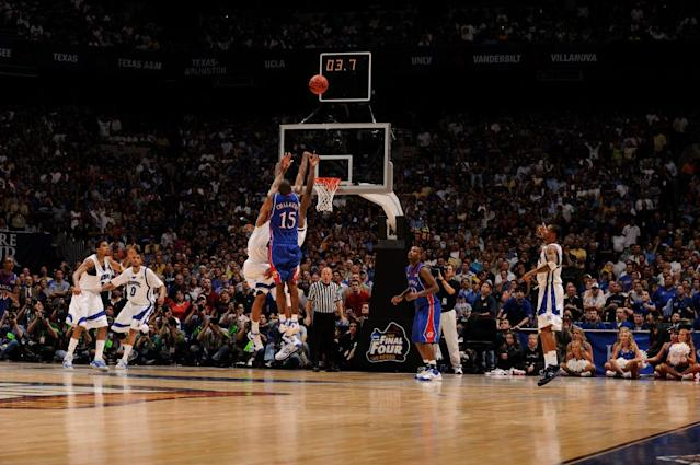 Mario Chalmers (15) of the University of Kansas hits a three point basket to send the game into overtime during the Division I Men's Final Four Basketball Championship Game held at the Alamodome in San Antonio, TX. Kansas defeated Memphis 75-68 to claim the championship title. (Getty)
