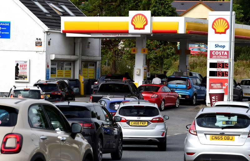 Cars queue up at a petrol and diesel filling station in Begelly