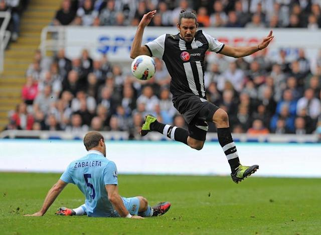 """Newcastle United's Argentinian midfielder Jonas Gutierrez (R) vies with Manchester City's Argentinian defender Pablo Zabaleta (L) during the English Premier League football match between Newcastle United and Manchester City at Sports Direct Arena in Newcastle, north-east England on May 6, 2012. AFP PHOTO/ANDREW YATES RESTRICTED TO EDITORIAL USE. No use with unauthorized audio, video, data, fixture lists, club/league logos or """"live"""" services. Online in-match use limited to 45 images, no video emulation. No use in betting, games or single club/league/player publicationsANDREW YATES/AFP/GettyImages"""