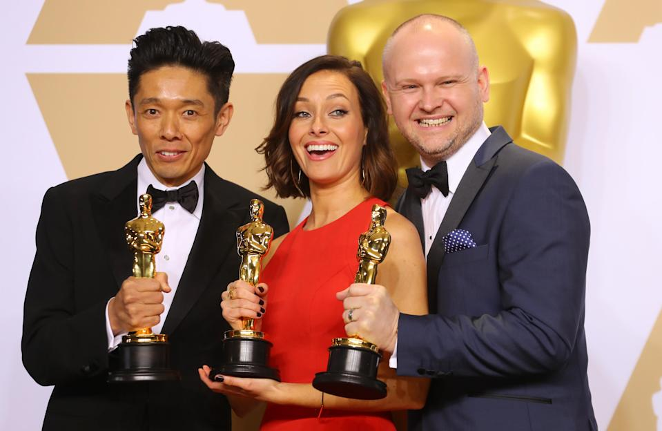 """90th Academy Awards – Oscars Backstage – Hollywood, California, U.S., 04/03/2018 – Kazuhiro Tsuji, Lucy Sibbick and David Malinowski with their award for Best Makeup and Hairstyling for the film """"Darkest Hour"""" REUTERS/Mike Blake"""
