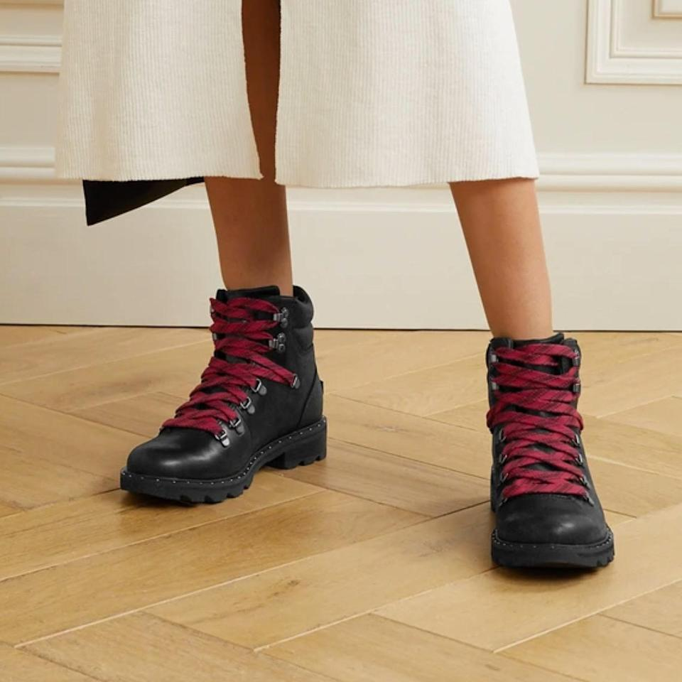 """If they're good enough for <a href=""""https://www.vogue.com/article/katie-holmes-sorel-hiker-boots-fall?mbid=synd_yahoo_rss"""" rel=""""nofollow noopener"""" target=""""_blank"""" data-ylk=""""slk:Katie Holmes"""" class=""""link rapid-noclick-resp"""">Katie Holmes</a>, they're definitely good enough for us. Sorel's Lennox hiking shoe is the perfect everyday boot. You can take cues from Holmes and pair these leather boots with <a href=""""https://www.glamour.com/gallery/best-high-waisted-jeans?mbid=synd_yahoo_rss"""" rel=""""nofollow noopener"""" target=""""_blank"""" data-ylk=""""slk:high-waisted jeans"""" class=""""link rapid-noclick-resp"""">high-waisted jeans</a> and a <a href=""""https://www.glamour.com/gallery/best-half-zip-sweaters?mbid=synd_yahoo_rss"""" rel=""""nofollow noopener"""" target=""""_blank"""" data-ylk=""""slk:half-zip sweater"""" class=""""link rapid-noclick-resp"""">half-zip sweater</a> while running errands, or you can wear them with <a href=""""https://www.glamour.com/story/where-to-shop-cute-workout-clothes?mbid=synd_yahoo_rss"""" rel=""""nofollow noopener"""" target=""""_blank"""" data-ylk=""""slk:cute workout clothes"""" class=""""link rapid-noclick-resp"""">cute workout clothes</a> while exploring a nearby park or forest. Another win for urban dwellers is that these are essentially built to withstand slush and rain: They're made from waterproof brushed leather and come with grippy rubber soles to keep you grounded on wet stairs or sidewalks. $240, Net-a-Porter. <a href=""""https://www.net-a-porter.com/en-us/shop/product/sorel/lennox-hiker-waterproof-brushed-leather-ankle-boots/1262092"""" rel=""""nofollow noopener"""" target=""""_blank"""" data-ylk=""""slk:Get it now!"""" class=""""link rapid-noclick-resp"""">Get it now!</a>"""