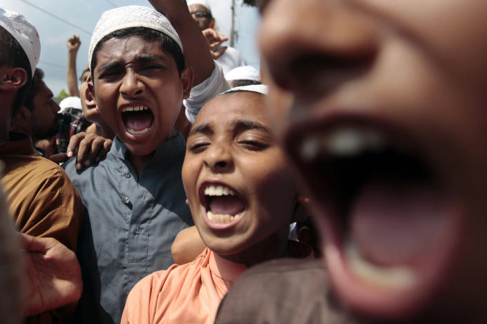 Supporters of a Bangladeshi Islamic political party shout slogans as they march during a strike in Dhaka, Bangladesh, Sunday, Sept. 23, 2012. Schools and businesses are closed and transportation has been disrupted across Bangladesh as hard-line Islamic groups protesting a film that denigrates the Prophet Muhammad enforce a general strike. (AP Photo/A.M. Ahad)
