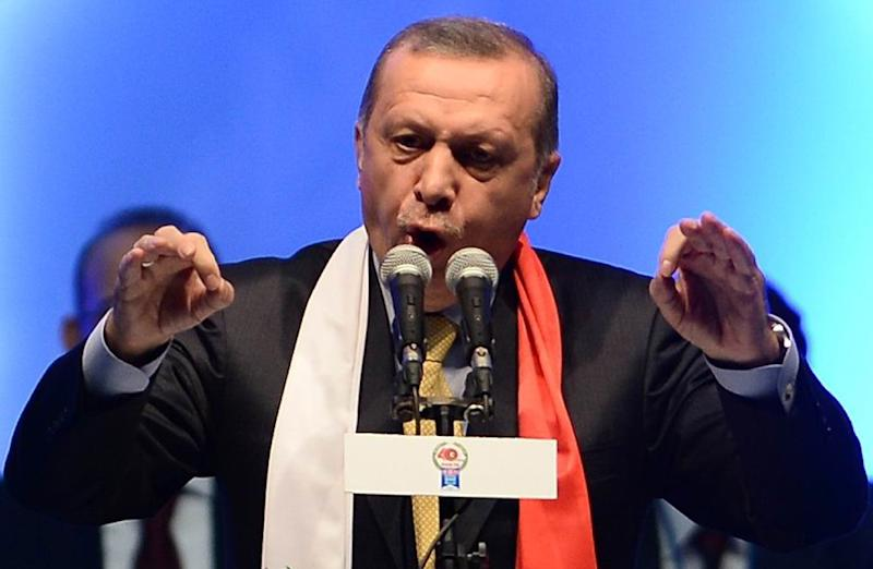 "Turkish President Recep Tayyip Erdogan has vowed to fight all Turkey's ""enemies"" as his Justice and Development Party (AKP) battles to regain a parliamentary majority (AFP Photo/Adem Altan)"