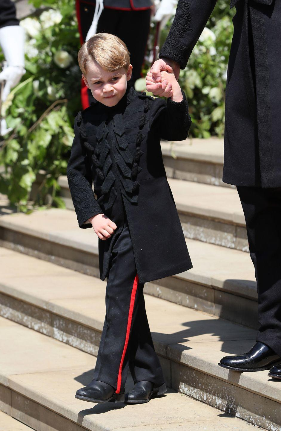 """<p>In the royal family, black is a color that is reserved for mourning, so members of the family, including children, are restricted from wearing it to <a href=""""https://www.whowhatwear.com/royal-family-wardrobe"""" rel=""""nofollow noopener"""" target=""""_blank"""" data-ylk=""""slk:daytime events"""" class=""""link rapid-noclick-resp"""">daytime events</a>. One exception? The military suit Prince George donned as the page boy at his uncle's wedding. </p>"""