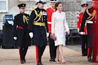 Kate made her debut at the Beating Retreat military ceremony to take the salute, wearing a repeat cream Catherine Walker coat with her Gianvito Rossi praline pumps, her Mulberry blush pink 'Amberley' clutch and her Cassandra Goad pearl stud earrings. [Photo: PA]