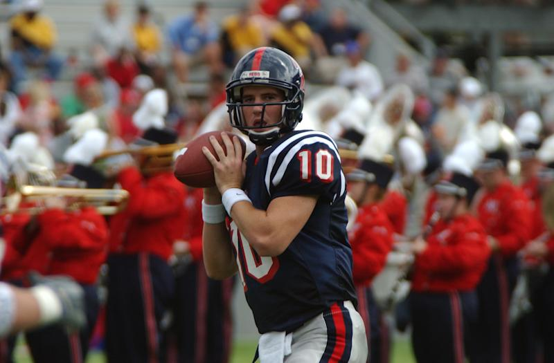 OXFORD, MS - OCTOBER 12 2001: Eli Manning, #10 quarterback of the University of Mississippi Rebels football team looks up field for an open receiver during a game on October 12, 2001 at Vaught-Hemingway Stadium in Oxford, Mississippi. (Photo by University of Mississippi/Getty Images)