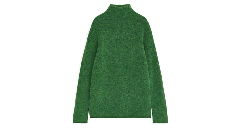 """Crafted from a blend of alpaca, RWS merino wool and recycled polyester, this slightly oversized jumper is ridiculously soft and made in one of this season's must-have colours. <a href=""""https://fave.co/2URUx06"""" rel=""""nofollow noopener"""" target=""""_blank"""" data-ylk=""""slk:Shop now."""" class=""""link rapid-noclick-resp""""><strong>Shop now.</strong></a>"""