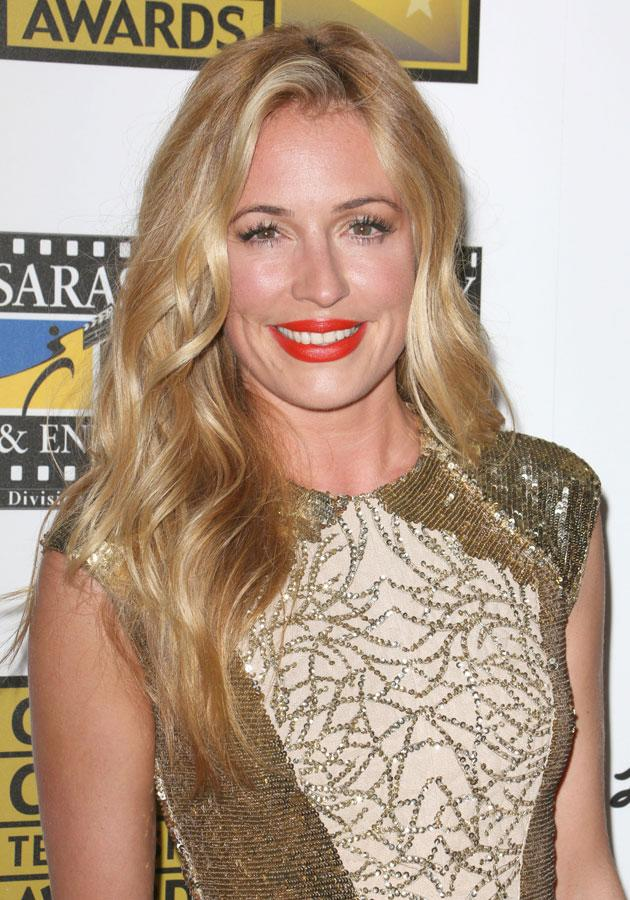 Cat Deeley opted for a stunning red-orange shade at the TV Critics Choice Awards. [Rex]