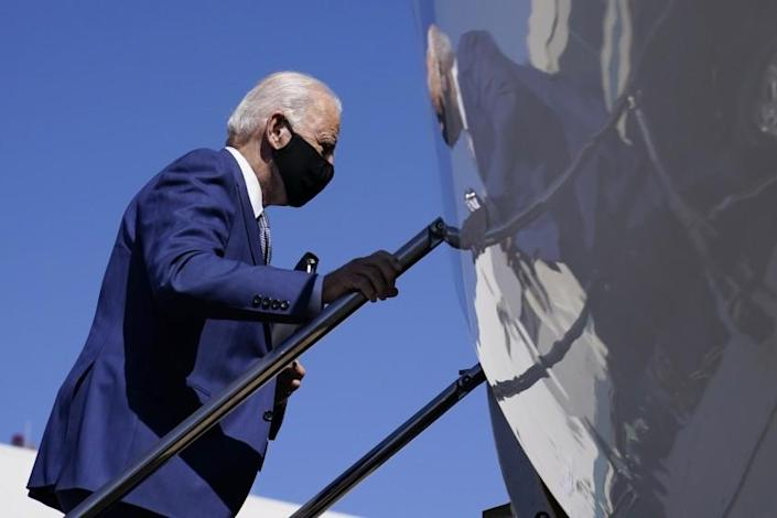 Democratic presidential candidate former Vice President Joe Biden boards a plane at New Castle Airport, in New Castle, Del., Monday, Sept. 21, 2020, en route to Manitowoc, Wis. (AP Photo/Carolyn Kaster)
