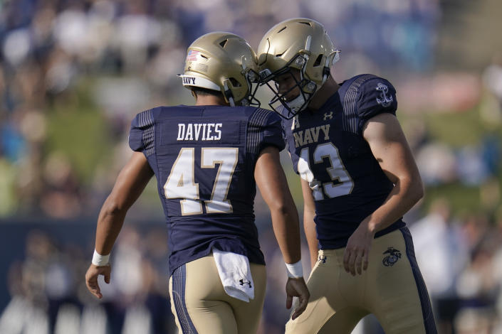 Navy place kicker Bijan Nichols, right, reacts with holder Daniel Davies after kicking an extra point against UCF during the first half of an NCAA college football game, Saturday, Oct. 2, 2021, in Annapolis, Md. (AP Photo/Julio Cortez)