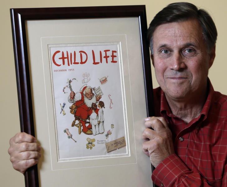 """Don Trachte of Bennington, Vt., poses with a1953 Child Life magazine cover illustration """"Santa's Helpers"""" by Norman Rockwell for which he modeled, at the Bennington Museum on Friday, Sept. 28, 2012, in Bennington, Vt. Trachte is the child on the left. (AP Photo/Mike Groll)"""