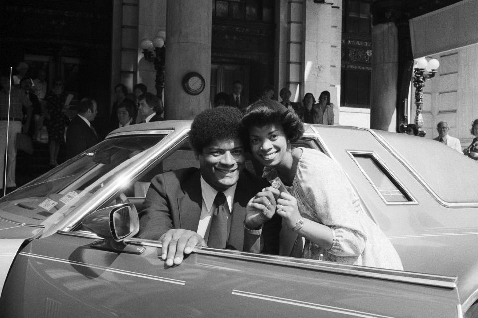 FILE - In this June 12, 1978, file photo, Wes Unseld and his wife Connie hold the keys to their new Thunderbird, presented to him by Sport magazine in New York. Unseld, the workmanlike Hall of Fame center who led Washington to its only NBA championship and was chosen one of the 50 greatest players in league history, died Tuesday, June 2, 2020, after a series of health issues, most recently pneumonia. He was 74. (AP Photo/Marty Lederhandler, File)