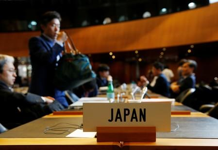 Members of the Japan delegation arrive for the General Council meeting at the World Trade Organization (WTO) in Geneva