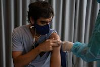 The Uruguayan government is placing its hopes for beating a world-record coronavirus infection rate on its vaccine campaign